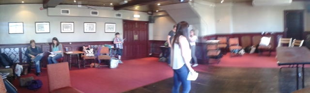 A panoramic view of one of the rehearsal rooms, three different scenes in progress